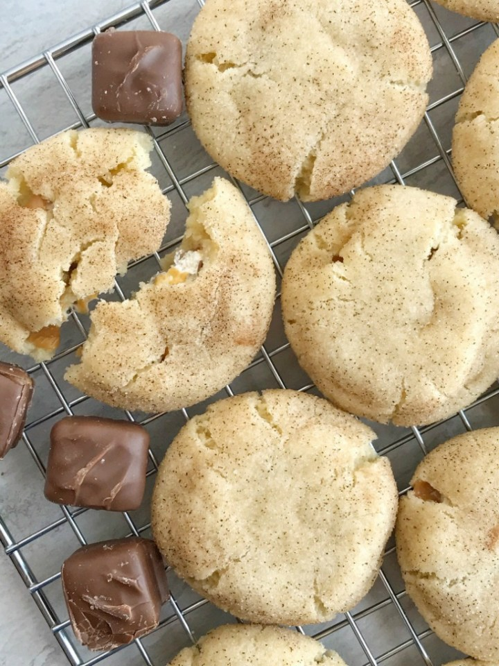 Caramel Apple Snickerdoodles | Snickerdoodle Cookies | Cookie Recipes | These caramel apple snickerdoodles are so soft, thick, & chewy and stuffed with a Caramel Apple Milky Way inside! Everyone's favorite cookie with a caramel apple twist. #cookies #dessertrecipe #easyrecipe #caramelapple