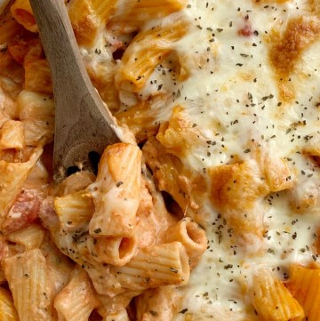 Pasta Bake with ziti pasta noodles, mozzarella cheese, cream cheese, jarred spaghetti sauce, diced tomatoes, and seasonings. Comes together in just minutes and it's a quick & easy dinner that's perfect for busy weeknights.