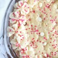 A soft baked sugar cookie cake that's filled with valentine's sprinkles and a vanilla almond frosting.