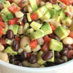 No party is complete without this addictive, super simple, and delicious game day dip! Full of beans, corn, avocado, red onion, tomatoes, and a surprise ingredient... Italian salad dressing.