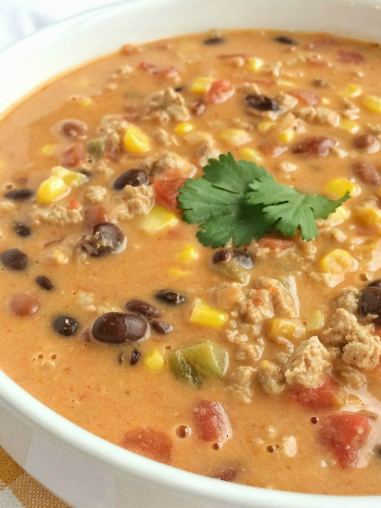 This easy cheesy taco soup take just minutes to prepare! Brown some ground turkeywith spices and combine it with six cans. Melt some Velveeta cheese into it and you have a smooth, creamy, and super delicious quick dinner.