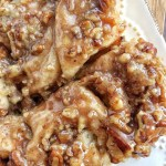 Overnight caramel pecan cinnamon rolls are so easy to make! Uses frozen bread dough and you prepare it the night before.