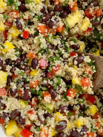 Mango black bean quinoa salad is a light & healthy salad. Protein packed quinoa, black beans, sweet mango, crisp red peppers, green onions, and cilantro covered in an easy olive oil vinaigrette dressing. It's also great for lunch prep!