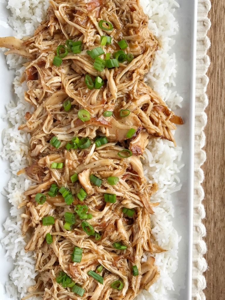 Slow cooker sweet garlic chicken is an easy & simple dinner that has loads of flavor. Chicken and an easy homemade sweet garlic sauce cook in the slow cooker all day. Serve over rice and garnish with green onions.