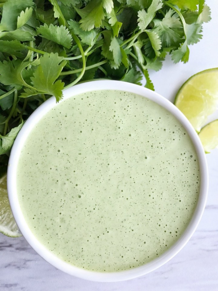 Cilantro lime salsa verde dressing is packed with so much flavor! Cilantro, salsa verde, and lime. This is so good served in rice bowls, over salads, with grilled chicken, as a dip with taquitos, or use for tacos and burritos. The options are endless.
