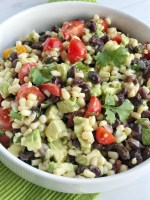 Fiesta avocado salad is loaded with avocados, corn, black beans, tomatoes, red onion, and cilantro covered in an easy citrus & olive oil dressing. This is the perfect side dish to any Mexican dinner, topping for tacos, nachos, or inside burritos.