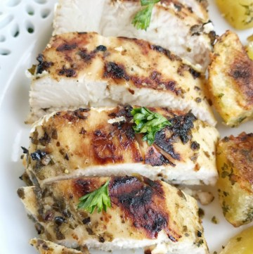 Fire up the grill for this delicious grilled pesto marinated chicken. Only 4 ingredients for an easy, delicious, and flavorful marinade! This is an easy dinner for busy weeknights or great for grilling at a BBQ.