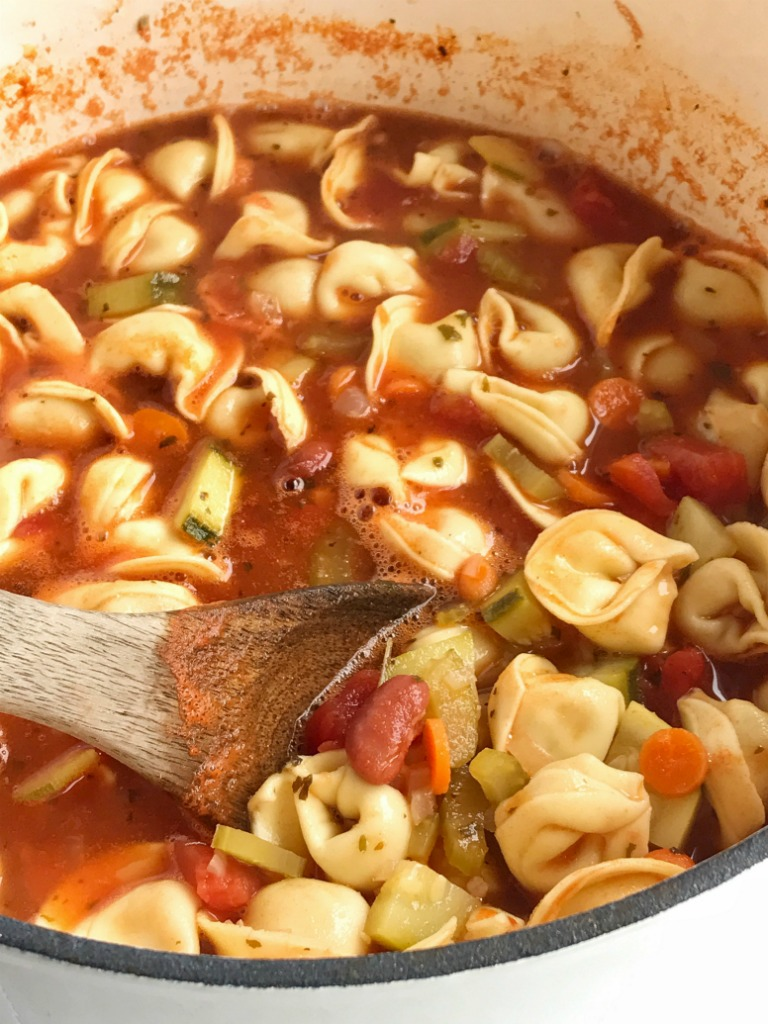 Tortellini minestrone soup is loaded with lots of healthy veggies, beans, and tender cheese filled tortellini. Simmer in a flavorful tomato vegetable stock broth for the ultimate comforting and healthy dinner.