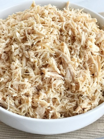 Have you ever wondered how to get flavorful chicken that is shredded just like in the restaurants? You don't want to miss these tips & tricks, and the recipe for how to cook perfectly shredded chicken in the crockpot. It's really easy and the results are the most delicious, tender, shredded chicken you'll ever have!