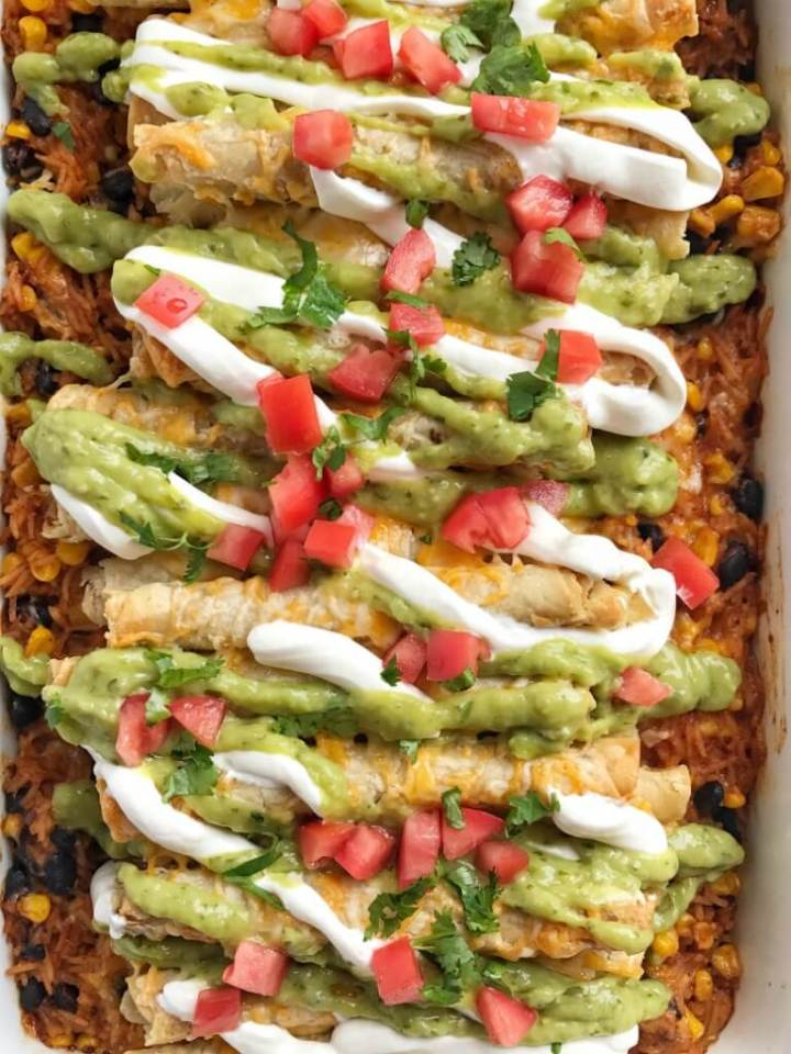 Frozen beef taquitos are a fun twist to this easy and quick enchilada casserole. Beef taquito enchilada casserole requires no chopping, no pre-cooking and only a couple minutes prep. So great for a busy weeknight. Serve with your favorite taco toppings for a yummy, kid-approved, and fun dinner!