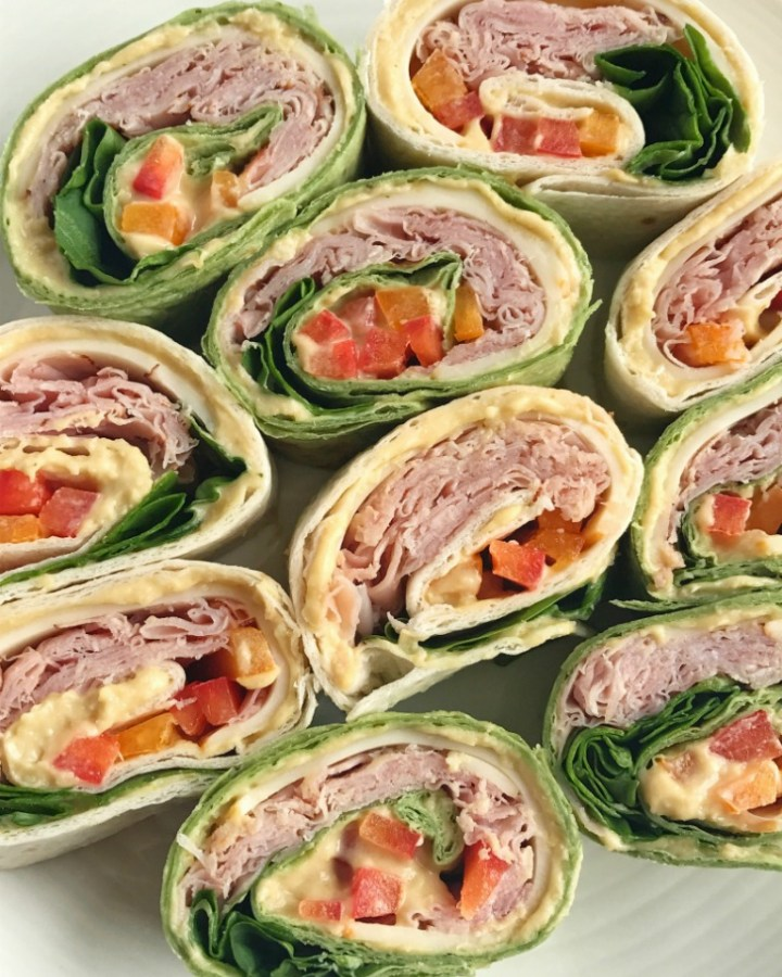 Healthy quick tortilla roll-ups are loaded with Eckrich Deli Meat, fresh vegetables, cheese, and hummus. These tasty hummus vegetable roll-ups make for a great after school snack, quick lunch, appetizer, or a light dinner. Quick & simple to prepare and loved by all!