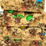 Monster cookie bars are a fun treat loaded with peanut butter, oats, chocolate chips, peanut butter chips, and mini m&m's. They bake up perfectly soft, chewy, and thick. A fun treat to make with the kids or great for back-to-school lunches or after school treat.