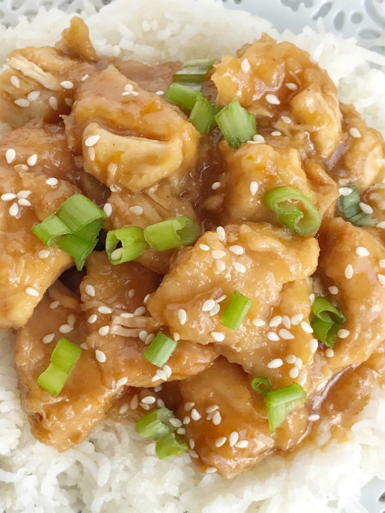 Slow cooker orange chicken is sweet, tangy, and better than take-out! Chunks of chicken cooked in a simple homemade orange sauce that is bursting with fresh orange flavor. Serve over rice for a delicious family approved dinner.