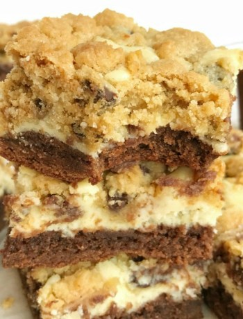 You won't believe how easy these chocolate chip cookie cheesecake brownie bars are to make! Convenient packages of brownie mix and chocolate chip cookies make these bars a cinch to prepare. Brownie base with a sweet cheesecake middle, and topped with chocolate chip cookies. These brownie bars are such a delicious dessert.