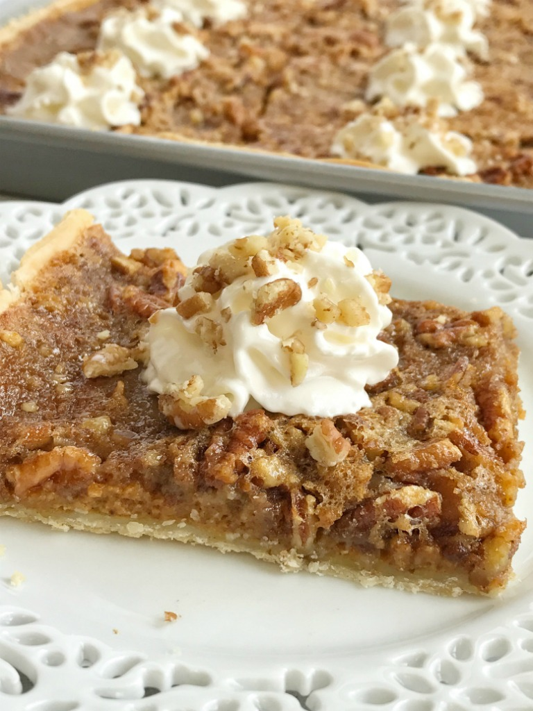 Pumpkin pecan slab pie combines the best desserts of Fall. An easy pie crust topped with a creamy pumpkin pie and finished off with pecan pie. It also makes enough for a crowd so it's perfect for all those Holiday gatherings, and it's pretty easy to make too.