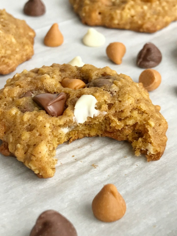 Soft baked, cake-like triple chip pumpkin oatmeal cookies are loaded with three kinds of chocolate; milk chocolate, butterscotch, and white chocolate! So soft and chewy, these pumpkin cookies are sure to be a hit. Pumpkin + warm pumpkin spices create a delicious cookie that's loaded with oats and chocolate chips for lots of texture.