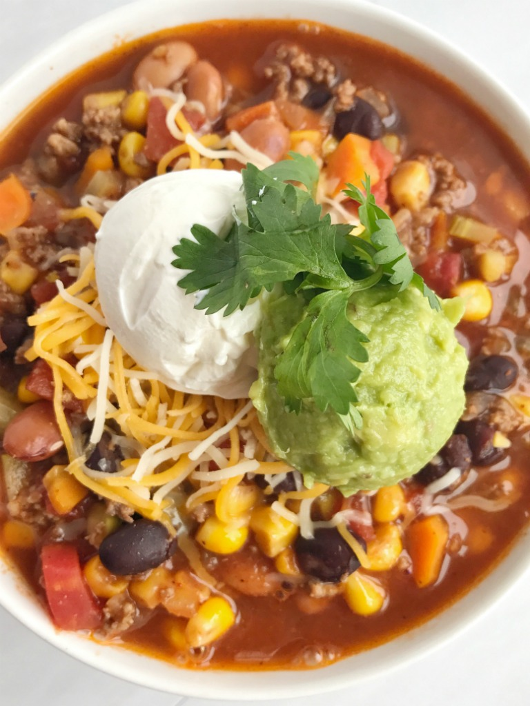 Taco chili with a twist! This veggie loaded taco chili is the best of two favorite soups. Loaded with vegetables, beans, seasoned ground beef and simmered in a flavorful broth. Healthy, delicious, warm & comforting, and sure to be a hit.