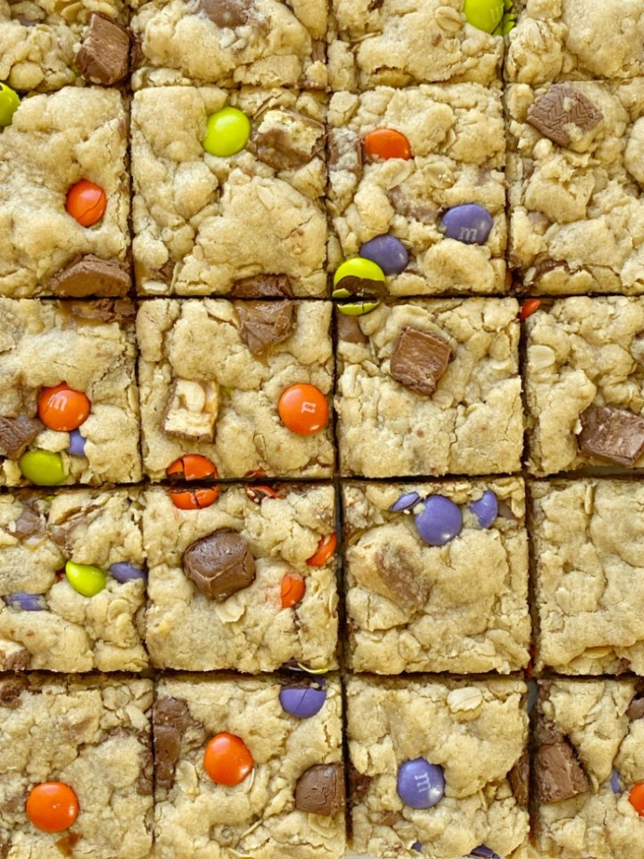 Leftover Halloween Cookie Bars are the best way to use up all that Halloween candy! Soft-baked, thick, chewy, peanut butter oatmeal cookie bars loaded with 2 cups of chopped candy. Kids will love to pick out the candy to put in these bars.