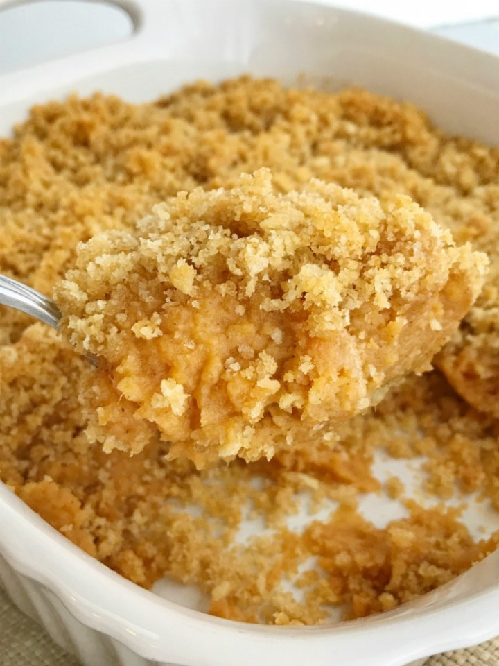 Buttery cracker sweet potato casserole can be on the dinner table in just 30 minutes! No boiling & peeling sweet potatoes. Sweet and creamy sweet potatoes topped with crunchy buttery cracker crumbs. This is such a fun twist to the classic casserole but so much easier. The perfect Thanksgiving side dish | www.togetherasfamily.com #sweetpotatocasserole #casserolerecipes #thanksgivingrecipes