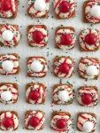 Peppermint Bark Pretzel Bites   white chocolate m&m candy. Perfect for Christmas cookie plates or just a fun Holiday treat   www.togetherasfamily.com #christmascookies #peppermintrecipes #peppermintdesserts #christmasdesserts #candycanerecipes