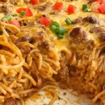 Cheesy taco spaghetti casserole is the ultimate dinner comfort food. Cheesy pasta loaded with taco seasoned ground beef, chili beans, and tomato. Bakes in one pan, serves a crowd, and the leftovers are fabulous for another meal! Together as Family #casserolerecipes #dinnerrecipes #recipeoftheday #casseroles #casserolerecipe