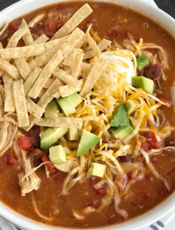 Chicken Tortilla Soup Recipe | The best 5 ingredient chicken tortilla soup only takes 20 minutes to make! One pot is all you need for this delicious and creamy tortilla soup. Combine 5 ingredients + some spices and let it simmer on the stove top. Top with cheese, avocado, chips, and sour cream.