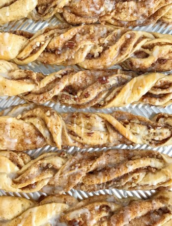 Maple Pecan Crescent Cinnamon Twists | These quick & easy 20 minute maple pecan cinnamon twists are made with refrigerated crescent dough and are perfect for brunch, a snack, and even a sweet breakfast treat. Buttery crescent dough filled with a pecan cinnamon mixture and baked to perfection! Top with a simple maple and powdered sugar glaze and enjoy!