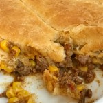 5 ingredient Mexican biscuit casserole is an easy, 30 minute casserole that is kid-approved! A hearty, ground beef Mexican filling is topped with cheese and flaky buttery biscuit dough. Serve with your favorite taco toppings for an easy family dinner | #easydinnerrecipes #casseroles #dinner #dinnerrecipe