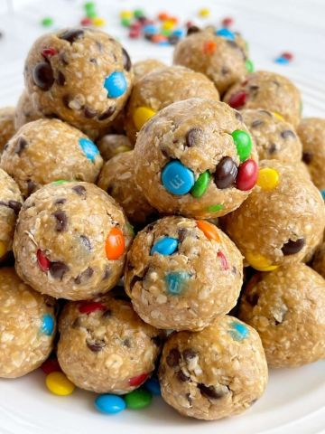 Monster cookie energy balls with only 6 ingredients like oats, peanut butter, honey, chocolate chips, and m&m.