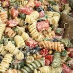 Caesar Pesto Pasta Salad | Pasta Salad Recipe | Salads | Side Dish | Caesar pesto pasta salad will be a hit at your next bbq, picnic, or dinner! Tender spiral pasta covered in a creamy Caesar pesto dressing, chopped tomatoes, olives, parmesan cheese, and pine nuts. So simple and easy to make and crazy delicious. #pastasalad #sidedish #saladrecipes