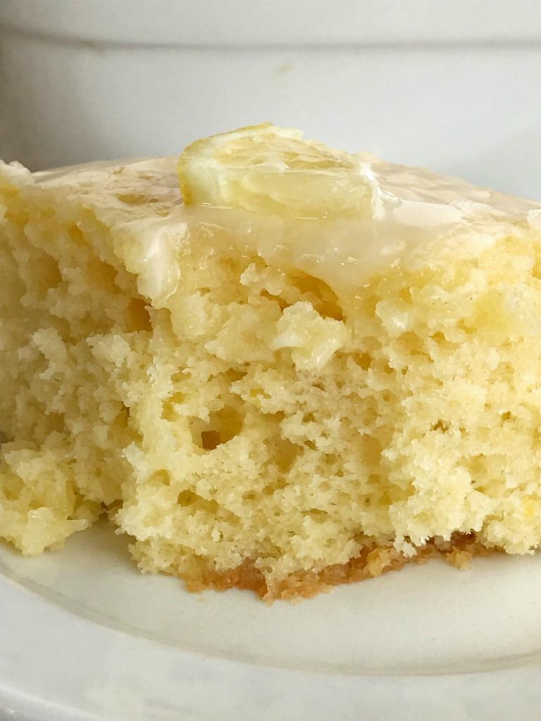 Glazed Lemon Yogurt Cake   Lemon Cake   Lemon Desserts   This homemade lemon cake is so moist, tender, soft, and delicious! Yogurt inside the cake and in the glaze on top. This lemon cake is the best dessert for summertime or anytime. #easydessertrecipes #dessert #lemondesserts #lemon