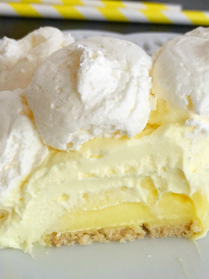 Lemon Cheesecake Cream Pie is a no bake dessert that is so creamy and bursting with fresh and sweet lemon flavor! Perfect for a summer dessert, at a bbq, or picnic. It's also a make ahead dessert that is so pretty and perfect for summer.