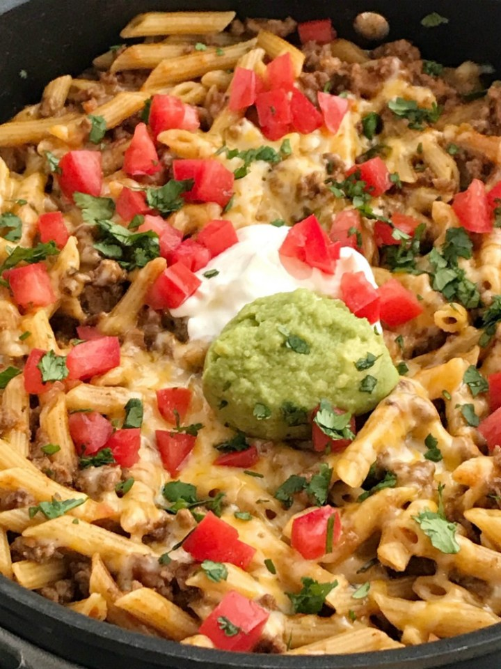 One Pan Beef Taco Pasta Skillet   Skillet Dinner   One Pan   Beef Taco Recipe   Pasta Recipe   One pan & 30 minutes is all it takes for cheesy beef taco pasta skillet dinner recipe. Tender pasta and taco seasoned ground beef simmer in salsa and beef broth and then gets covered in cheese. Serve with all your favorite taco toppings for an easy and simple dinner. #easydinnerrecipes #skilletmeals #onepan