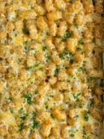 Chicken pot pie tater tot casserole is a kid-friendly, family favorite dinner recipe that everyone loves! A creamy chicken and vegetable mixture gets topped with crispy tater tots and cheese. So delicious and a sure win for dinner time.