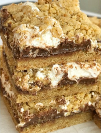 S'mores Cookie Bars | S'mores Recipe | Cookie Bars | S'mores | Get ready for summer with these delicious S'mores Cookie Bars. Graham cracker cookie dough is layered with marshmallow cream and Hershey milk chocolate bars for a dessert that is reminiscent of everyone's campfire favorite treat. #dessertrecipes #easydessertrecipes #smores #chocolate