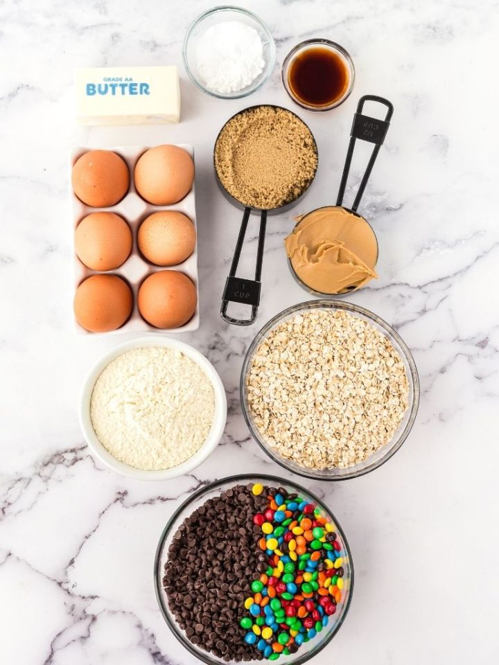 Ingredients needed to make monster cookies with the ingredients shown in an overhead shot.