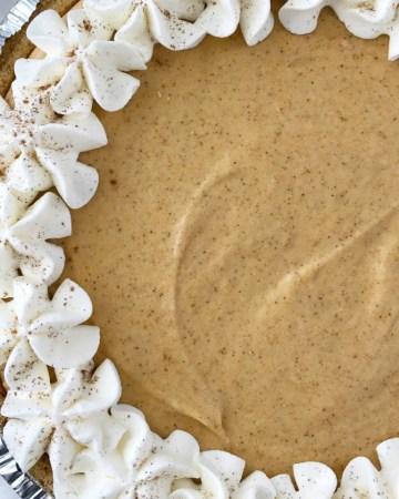 No Bake Marshmallow Pumpkin Pie   Pumpkin Pie Recipe   No Bake Pie   No Bake Pumpkin Pie   No bake marshmallow pumpkin pie is a sweet and fluffy twist to classic pumpkin pie. Marshmallow, Cool whip, and pumpkin combine to make a delicious pumpkin pie in a store-bought graham cracker crust. #pumpkin #pumpkinspice #nobake #dessert #easydessert #recipe #recipeoftheday