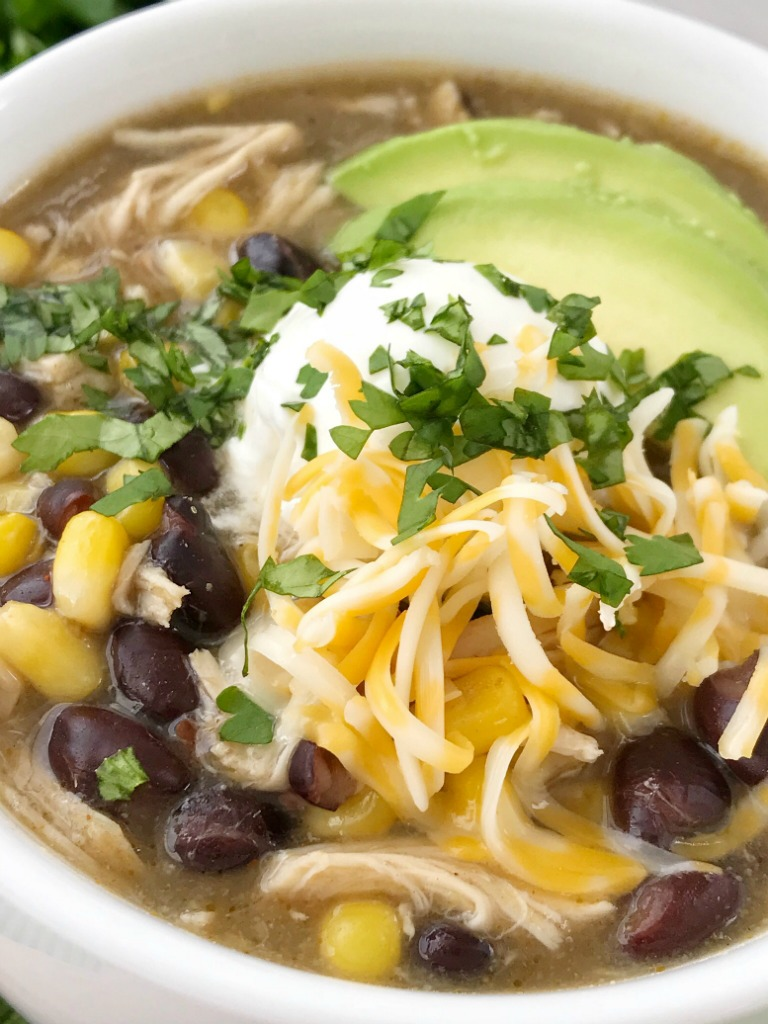 Chicken Enchilada Soup   Soup Recipe   Chicken Recipe   Chicken enchilada soup made in the slow cooker. Loaded with chicken, black beans, corn, that simmers in a green chili enchilada sauce and chicken broth in the crock pot. Serve with avocado, sour cream, cheese, and chips!