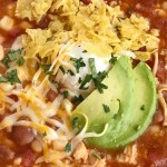 8 Can Chicken Chili | Chicken Chili Recipe | 30 Minute Dinner | 8 can chicken chili is a quick & easy dinner that be ready in no time at all. You literally dump 8 cans into a soup pot plus seasonings! This is surprisingly so delicious and comforting. Top with sour cream, shredded cheese, tortilla chips, and avocado slices. #dinner #easydinnerrecipes #recipeoftheday #soup #chickenrecipes #chilirecipes #chicken #chili