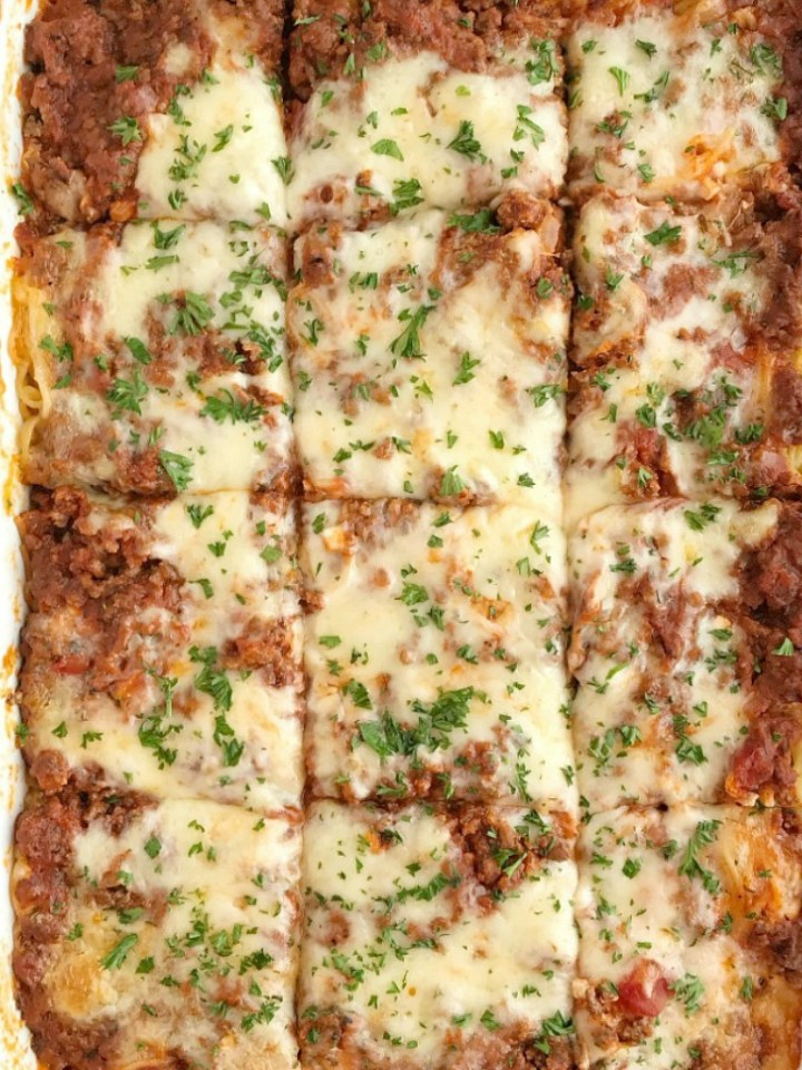 Baked Spaghetti Casserole is a family favorite dinner that's filled with pasta, cheese, and an easy semi-homemade ground beef meat sauce. This gets gobbled up even by the pickiest eaters when I make it for dinner. Serve with a salad and garlic bread for a delicious and heart family dinner.