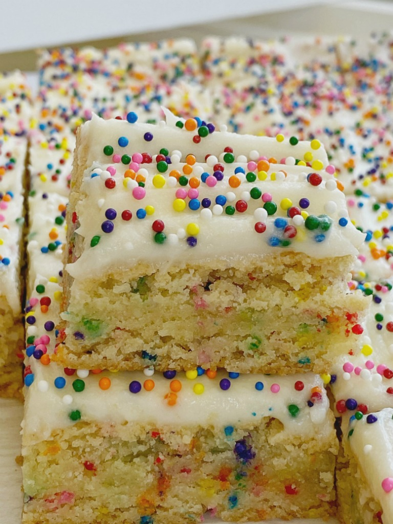 Funfetti Cake Batter Cookie Bars are so easy to make with a cake mix and sugar cookie mix, loaded with colorful sprinkles, and tastes exactly like cake batter. These will be a hit with everyone.