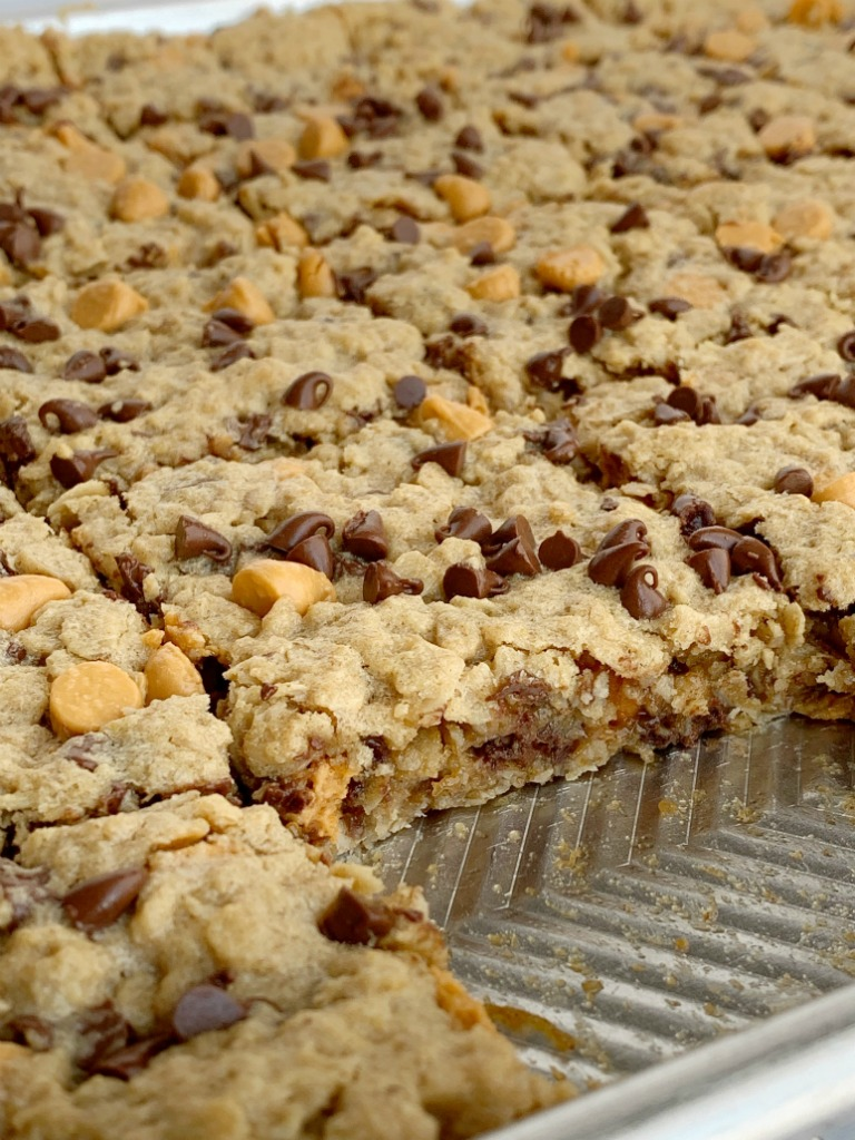 Chewy butterscotch peanut butter cookie bars have no flour! Hearty, chewy, soft baked, and loaded with chocolate and butterscotch chips. This cookie bar recipe makes lots of cookie bars so it's perfect for snacks (freeze extras) or big gatherings.