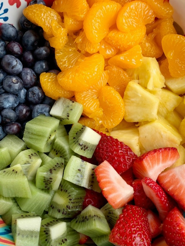 Lemon Yogurt Fruit Salad | Fruit Salad | Salad Recipe | Fruit salad with a creamy lemon yogurt dressing. Fresh pineapple, strawberries, blueberries, kiwi, and canned mandarin oranges are drizzled with a fresh lemon juice & lemon yogurt dressing. #fruitsalad #healthyrecipe #sidedish #summerrecipes #saladrecipes