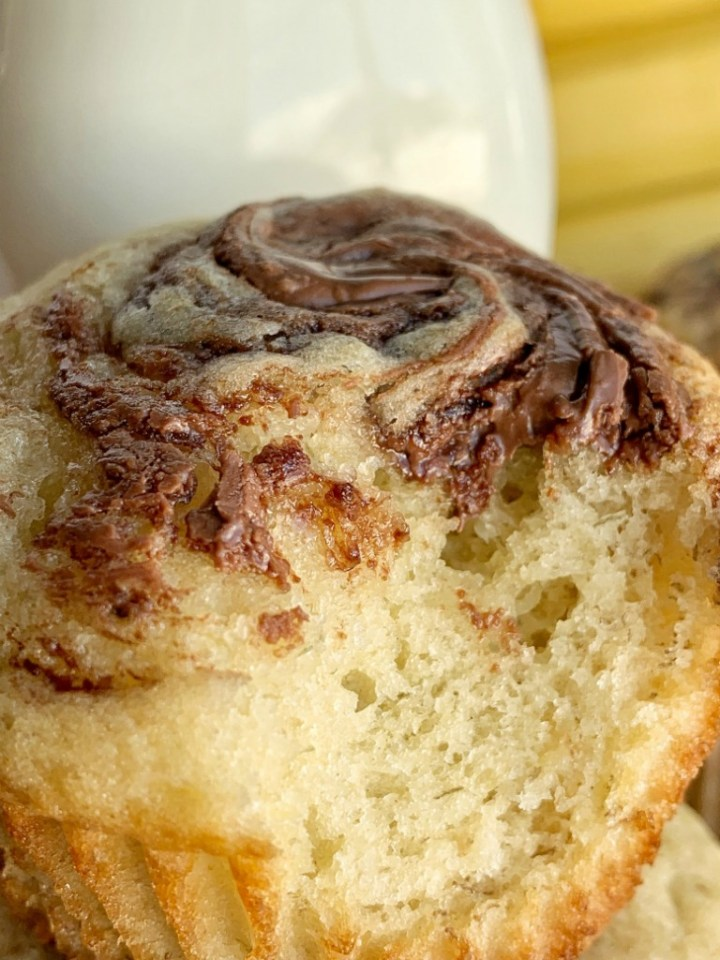 Nutella Swirl Banana Muffins | Banana Muffins | Nutella Recipes | Banana muffins with a sweet Nutella swirl on top! The perfect banana muffin recipe with Nutella. A great after school snack and a delicious way to use up those ripe brown bananas. #muffinrecipes #bananamuffins #snackideas #snackrecipes #recipeoftheday #easyrecipeideas