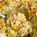 Ham & Broccoli Rice Casserole   Casserole Recipes   Casserole   Dinner Recipes   Broccoli Rice Casserole is loaded with flavorful rice, carrots, corn, chopped ham, and cheese. This rice casserole is a great way to use up leftover ham, bakes up in one pan, and it's a family favorite. #casserole #dinnerrecipes #dinner #recipeoftheday