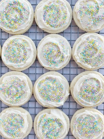 Perfect Sugar Cookies | Sugar Cookie Recipe | This is the only sugar cookie recipe you'll need! Perfectly soft-baked, thick, chewy, and so creamy thanks to the surprise ingredient - cream cheese! Topped with a sweet & simple powdered sugar frosting. Change up the sprinkles for all different Holidays! #sugarcookies #cookierecipes #dessertrecipes #recipeoftheday