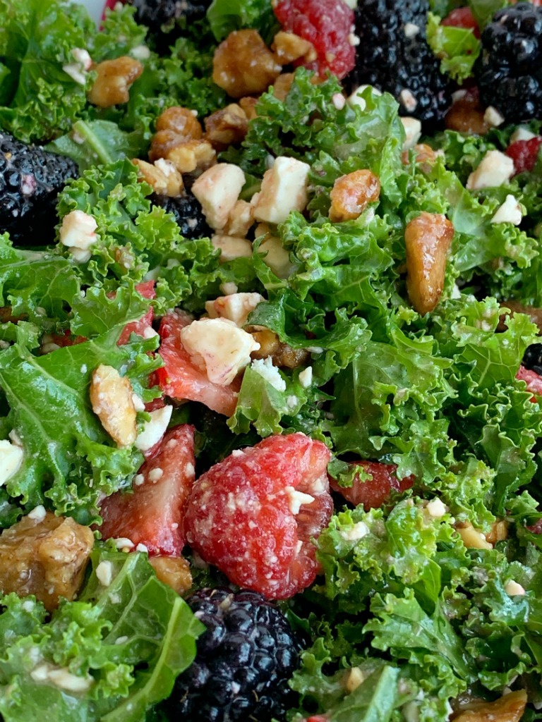 Citrus Berry Kale Salad | Kale Salad | Healthy Salad Recipe | Kale Salad with fresh strawberries, raspberries, and blackberries! Topped with feta cheese, glazed walnuts and a super simple homemade citrus olive oil dressing. This salad can make anyone a kale fan. #kalesalad #kalerecipes #healthyrecipes #salad #sidedish #saladrecipes #recipeoftheday #summerrecipes
