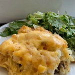 Cheeseburger Tater Tot Casserole | Tater Tot Casserole | Casserole Recipes | Tater Tot Casserole with a cheeseburger twist! Perfectly seasoned ground beef topped with a biscuit crust, crispy tater tots, and lots of cheese! Everyone will love this tater tot casserole. #groundbeefrecipes #casserole #casserolerecipes #dinner #easydinnerrecipes #recipeoftheday