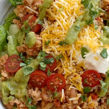 Ground Turkey Taco Salad Bowls | Taco Salad Bowls | Ground Turkey Recipes | Healthy Ground Turkey Taco Salad Bowls are made in one pot on the stovetop! Just like a taco salad with fresh green lettuce, topped with a flavorful & healthy ground turkey and brown rice mixture, and loaded with all your favorite taco toppings. #healthyrecipe #healthydinnerrecipes #groundturkeyrecipes #groundturkey #healthy #dinner #dinnerrecipe #recipeoftheday