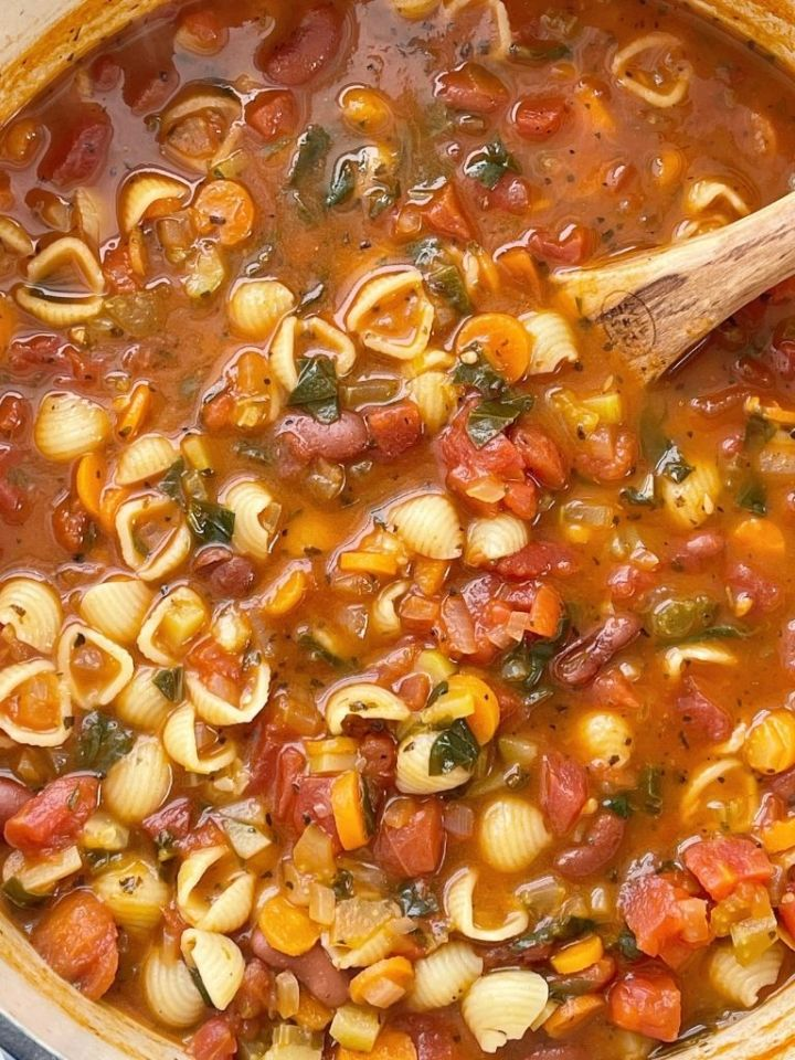 Minestrone soup is a healthy soup recipe with beans, pasta, vegetables that simmers in a tomato sauce vegetable broth base.